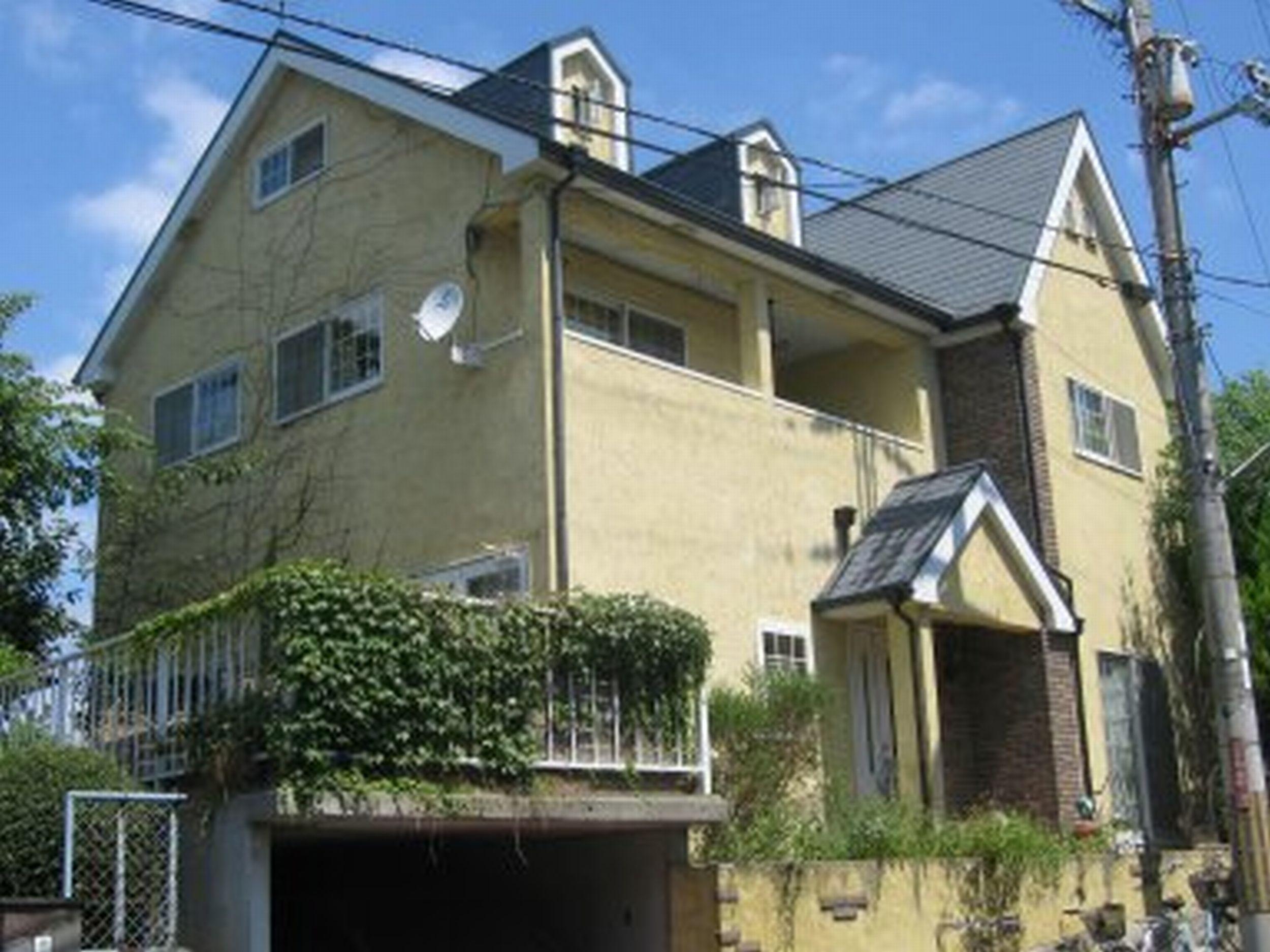 幸せのイエローウォールの家